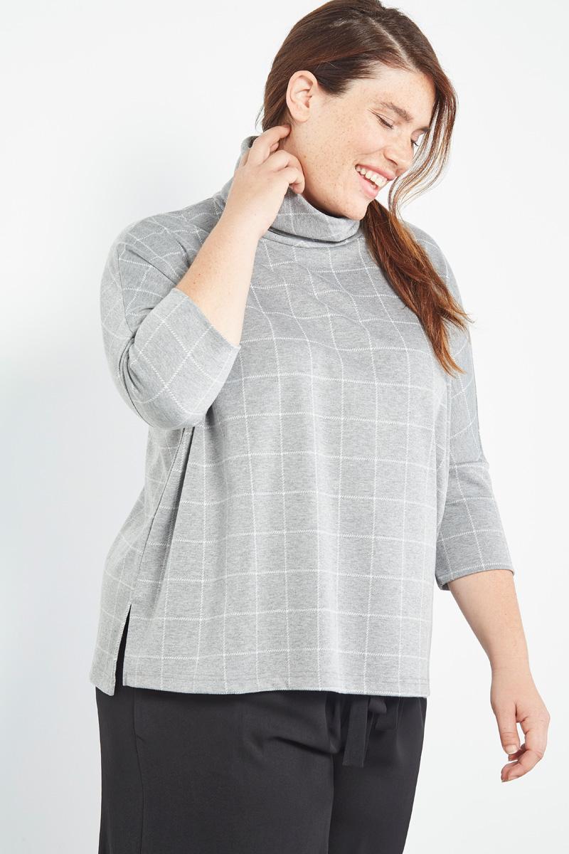 Collection capsule #curveIRL par #collectionIRL disponible sur Showroomprivé, pull gris et blanc à carreaux pour femme.